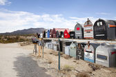 Rows of mailboxes in desert — Stock Photo