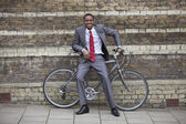 Young businessman with bicycle — Stockfoto