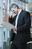 Business man reads document — Stock Photo