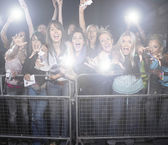 Female fans screaming and cheering — Stock Photo