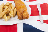 Junk food over British flag — Stock Photo