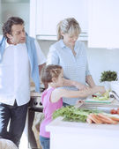 Family making a healthy salad — Stock Photo