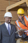 African American businessman and industrial worker — Stock Photo