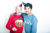 Adult man and a young man wearing Christmas jumpers — Stock Photo