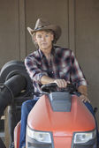 Cowboy driving utility vehicle — Stockfoto