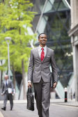 African American businessman with bag — Stock Photo