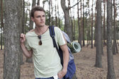 Man hiking in woods — Stock Photo