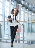 Businesswoman runs towards camera — Stock Photo
