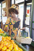 Woman shopping for fruits — Stock Photo