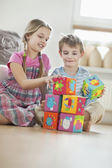 Children stacking blocks — Stock Photo