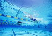 Swimmers racing — Stock Photo
