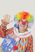 Senior male clown waving hand — Stock Photo