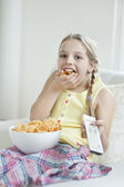 Girl eats snack — Stock Photo