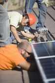 Men working on solar panelling — Stock Photo