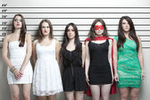 Woman in superhero costume with friends in police lineup — Stock Photo