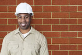 Happy young construction worker — Stock Photo