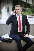 Young businessman using cell phone — Stock Photo