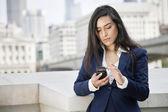 Indian businesswoman using smart phone — Stock Photo