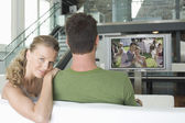 Woman with man watching movie — Stock Photo