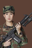 Female Marine Corps soldier holding M4 assault rifle — Stock Photo