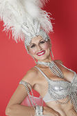 Senior showgirl with feather headpiece — Stock Photo