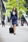 Indian businesswoman with luggage — Stock Photo