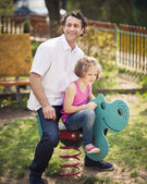 Father and daughter on playground — Foto Stock