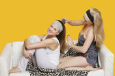 Woman combing friend's hair — Stock Photo