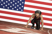 Runner  in starting block — Stock Photo
