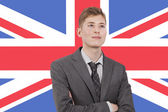 Young businessman over British flag — Stock Photo