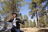 Senior woman riding motorcycle — Stock Photo