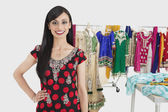 Dressmaker standing with hand on hip — Stock Photo