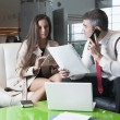 Businessman and businesswoman at meeting — Stock Photo #33997243