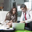 Businessman and businesswoman at meeting — Stock Photo #33990091