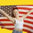 Woman holding American flag — Stock Photo #33990369