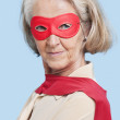 Senior woman wearing superhero costume — Stock Photo