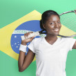 Woman with tennis racket against Brazilian flag — Stock Photo #33990933