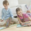 Siblings reading books — Stock Photo #33991003