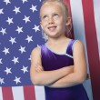 Gymnast in front of American flag — Stock Photo