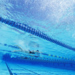 Swimmers racing together — Foto Stock