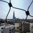 London behind wire net — Stock Photo