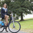 Stock Photo: Businesswomriding bicycle