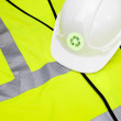 Safety vest and hard hat with recycling symbol — Stock Photo