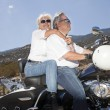 Senior couple riding a motorcycle — Stock Photo #33995571