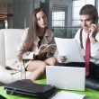 Businessman and businesswoman at meeting — Stock Photo #33995675