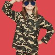 Girl in military uniform saluting — Stock Photo #33997605