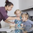 Mother with children baking — Stock Photo