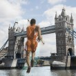 Athlete about to vault over Tower Bridge — Stock Photo