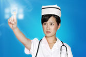 Nurse using futuristic touch screen — Stock Photo