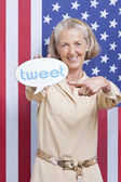 Senior woman with tweet bubble — Stok fotoğraf